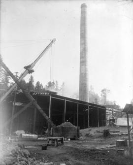 [Partially constructed Brentwood Bay Steam Plant, showing reinforced concrete smoke stack and fue...