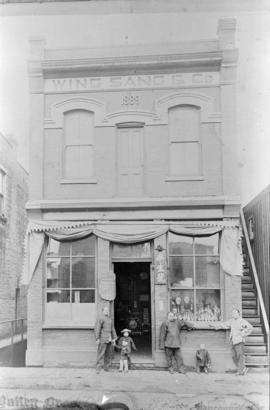 Yip Sang with children and family members in front of Wing Sang Company building at 51 East Pende...