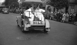 [Two Shriners in an open car during a Shriner parade along Burrard Street]