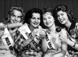 Four Miss P.N.E. 1960 contestants posing with food