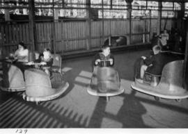 Children in bumper cars in midway carnival