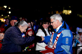 Premier Gordon Campbell hands out pins at Maple Ridge's Community Celebration in British Col...