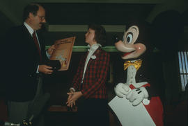 Mike Harcourt, unidentified woman and Mickey Mouse at City Hall