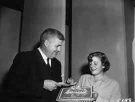 Dignitary presenting girl with award