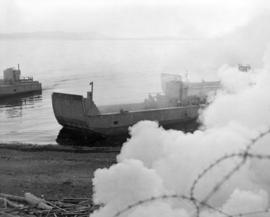 [Demonstration of an assault landing by an LCM (landing craft, mechanized) at Kitsilano Beach dur...