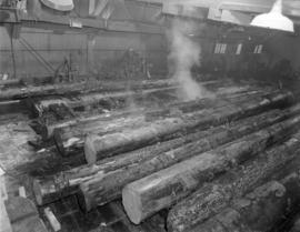 [Taking the bark off logs in] Sawmill [at] Pacific Mills