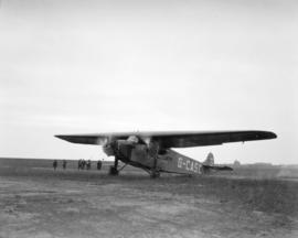 [Fokker FVII/3m aircraft G-CASC at airport, operated by Western Canada Airways Ltd.]