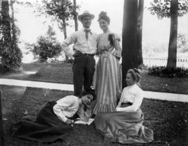 [Caroline Little Pierce outdoors with two unidentifed women and a man]