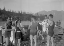 Swimmers standing on a dock