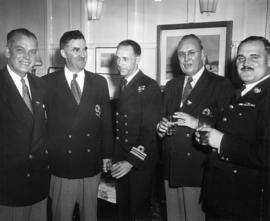 A.W. Gross, A.M. James, and J.C. Hackney with Royal Navy officers