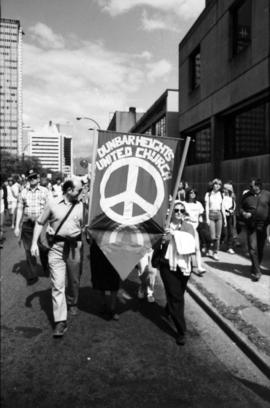 Peace march showing Dunbar Heights banner