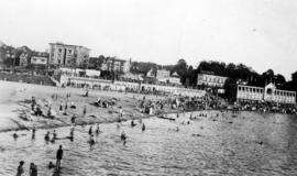 [English Bay, showing beach and buildings at corner of Davie Street and Denman Street]