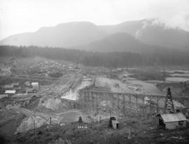 [Partially constructed Coquitlam dam, looking west along centre line of dam]