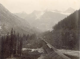 "[View of C.P.R. trestle bridge and ""The Loop"" in the Selkirk Range]"