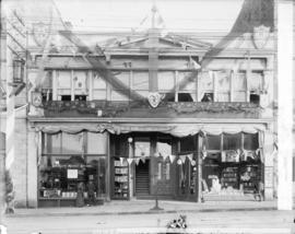 [Exterior of Boult's Music Store and N. Caple and Co. Stationers, decorated for the visit of...