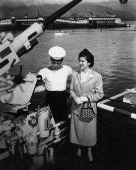 Miss P.N.E. contestant with sailor aboard the H.M.S. Sheffield