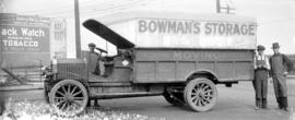 Bowman's Storage truck [and three unidentified men]