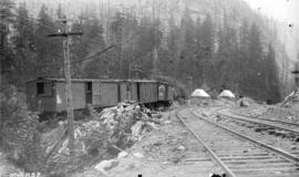 [C.P.R. work train boarding cars in Selkirk mountains]