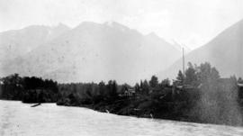 [View of buildings beside a river]