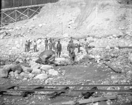 [Men clearing rocks from Coquitlam Dam construction site]