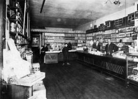 Interior of Grandview Table Supply grocery store with the shopkeeper and his assistants