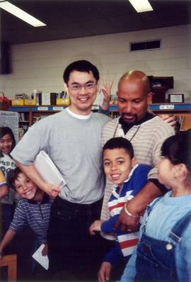 Paul Yee with students and a staff member at Dundas Elementary School, Toronto
