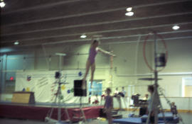 Young woman balancing on tight rope
