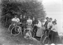 [Group of men and women with bicycles in park]