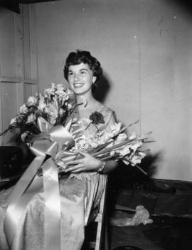 Winner of Miss Vancouver posing with flowers