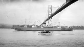 M.S. Atlantis [passing under Lions Gate Bridge]