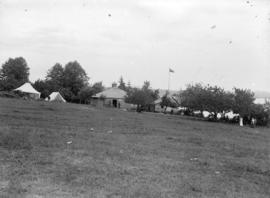 [Cottages and tents on Tom Turner's orchard, Moodyville (North Vancouver)]