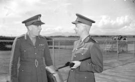 [Lieutenant General Kenneth Stuart being greeted at the airport by Brig. A.W. Sparling]