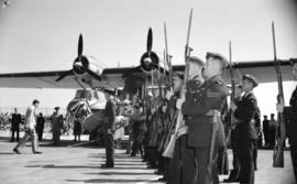[Soldiers with guns standing at attention at launching of first bomber produced at the Sea Island...
