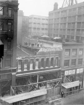 [A building being demolished for the expansion of the Woodward's Store at Hastings Street and Abb...