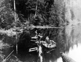 [Men fishing from rafts]