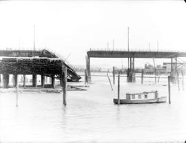 [Fire damaged section of Connaught Bridge (Cambie Street Bridge) collapsed into False Creek]