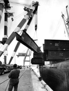 "Unloading steel beams from freighter ""Spruce"" at Centennial Pier, berth five"