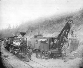 [Steam locomotive and construction engine and crew near Salmom River Bridge]