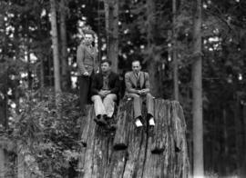 [Men sitting on stump waiting to see King George VI and Queen Elizabeth]