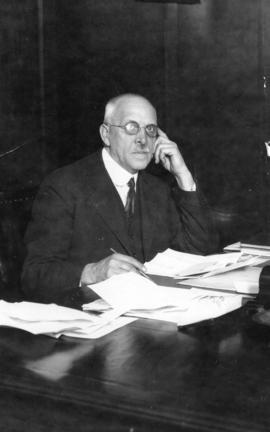 His Worship W.R. Owen sitting at his desk