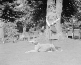 [Woman and her dog in park]