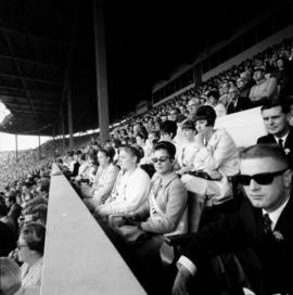 Miss P.N.E. 1966 contestants watching football game in Empire Stadium