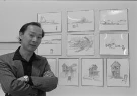 Artist Raymond Chow at a display of his drawings