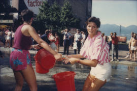 """Giant Fire Drill"" participants pass buckets of water"