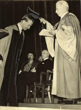 Chancellor McKechnie conferring honorary L.L.D. degree on Lord Tweedsmuir