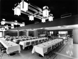 Interior of banquet hall, tables set, at P.N.E.
