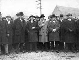 [Mayor L.D. Taylor standing outdoors with a group of men]