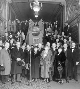 "[Group portrait in the entrance to the Capital Theatre for the premier of the movie ""Silent ..."