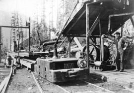 [A construction engine hauling lumber for the construction of Buntzen Lake Dam]