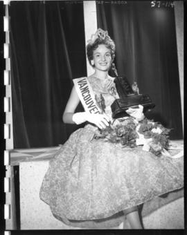 Winner of Miss Vancouver 1957 posing with trophy and flowers